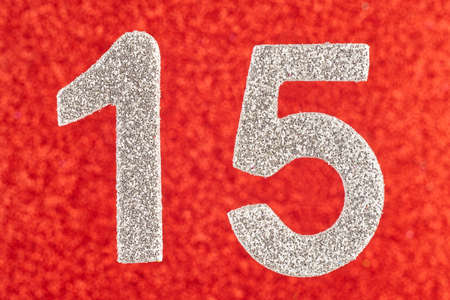 fifteenth: Number fifteen white color over a red background. Anniversary. Horizontal