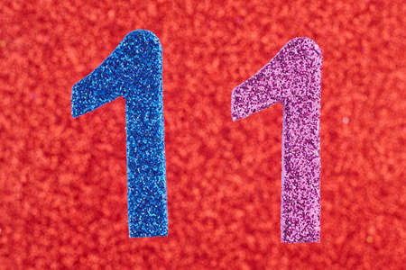 eleventh birthday: Number eleven blue purple color over a red background. Anniversary. Horizontal