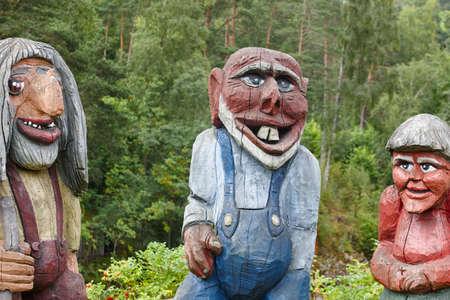 troll dolls: Norwegian carved wooden troll sculptures. Scandinavian folklore. Norway. Horizontal Stock Photo