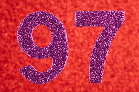Number ninety-seven purple color over a red background. Anniversary. Horizontal Stock Photo