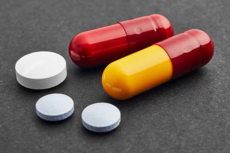 medicament: Pills over a black background. Medicament treatment. Health care photo Stock Photo