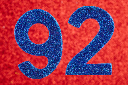 Number ninety-two blue color over a red background. Anniversary. Horizontal Stock Photo