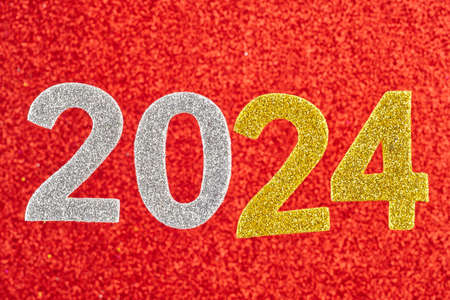 Number two thousand and twenty four over a red background. Anniversary. Horizontal