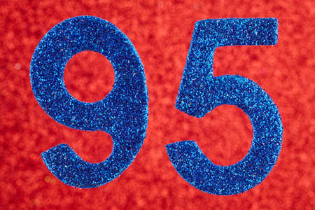 Number ninety-five blue color over a red background. Anniversary. Horizontal Stock Photo