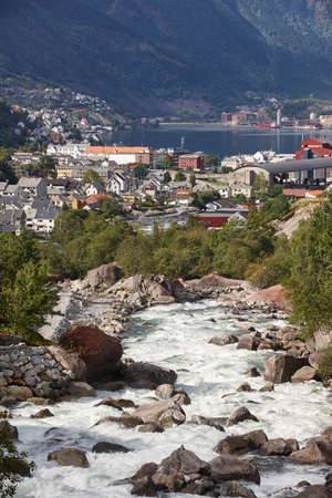 hardanger: Traditional norwegian fjord village with river. Odda. Travel Norway. Tourism
