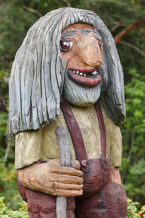 troll dolls: Norwegian carved wooden face detail troll. Scandinavian folklore. Norway. Vertical