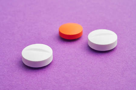 medicament: Pills over a purple background. Medicament treatment. Health care photo Stock Photo