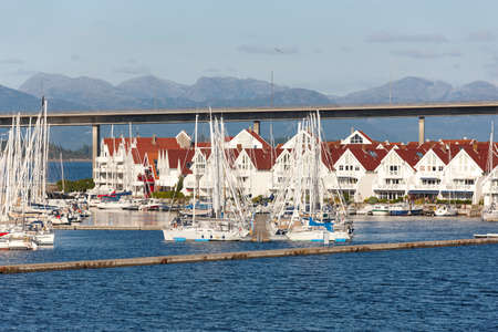 Traditional norwegian harbor village with houses and yatchs. Stavanger. Norway. Horizontal Stock Photo