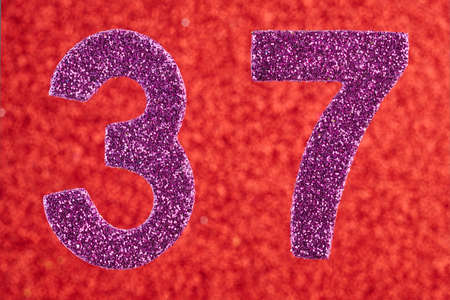 Number thirty-seven purple color over a red background. Anniversary. Horizontal