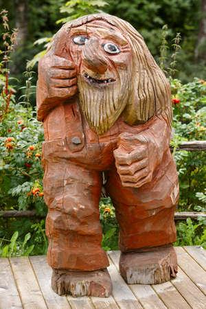 troll dolls: Norwegian carved wooden troll. Scandinavian folklore. Norway. Vertical Stock Photo