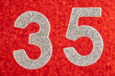 Number thirty-five silver color over a red background. Anniversary. Horizontal Stok Fotoğraf