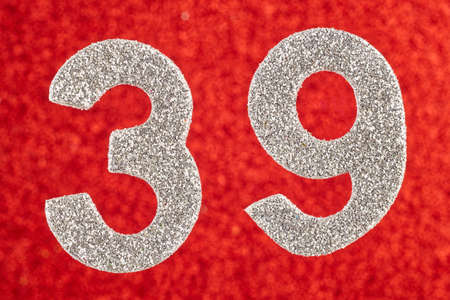 Number thirty-nine silver color over a red background. Anniversary. Horizontal