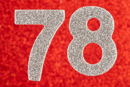 Number seventy-eight silver color over a red background. Anniversary. Birthday