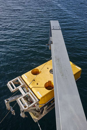 prospection: Scientific submarine robot with crane ready to be submerged. Research Stock Photo
