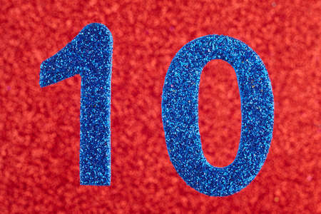 eleventh birthday: Number ten blue color over a red background. Stock Photo