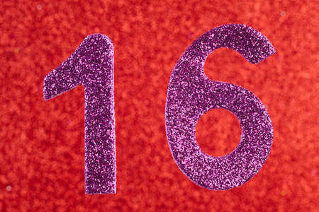 Number sixteen purple color over a red background. Anniversary. Horizontal Stock Photo