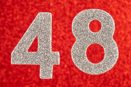 Number forty-eight silver color over a red background. Anniversary. Horizontal