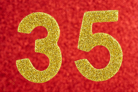 Number thirty-five yellow color over a red background. Anniversary. Horizontal Stok Fotoğraf