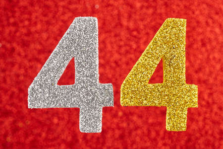 Number forty-four silver yellow color over a red background. Anniversary. Horizontal