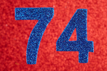 seventy: Number seventy-four blue color over a red background. Anniversary. Horizontal