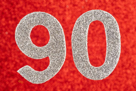 Number ninety silver color over a red background. Anniversary. Horizontal