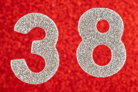 Number thirty-eight silver color over a red background. Anniversary. Horizontal