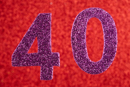Number forty purple color over a red background. Anniversary. Horizontal Stock Photo