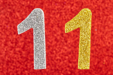 eleventh birthday: Number eleven silver yellow color over a red background. Anniversary. Horizontal