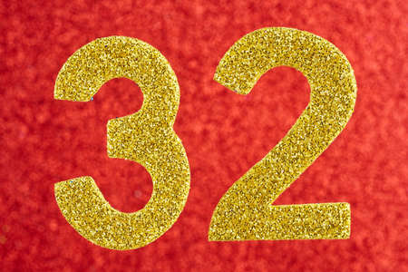 Number thirty-two yellow color over a red background. Anniversary. Horizontal