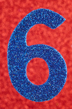 Number six blue color over a red background. Anniversary. Vertical Stock Photo
