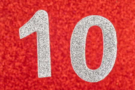 eleventh birthday: Number ten silver color over a red background. Anniversary. Horizontal