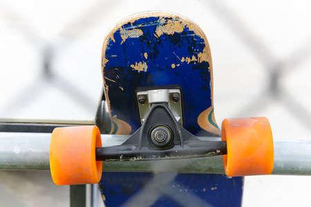 skateboarder: Skateboard detail and skater. Street urban background. Outdoor lifestyle