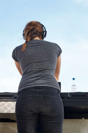 sexy girl dance: Young female dj with blue sky background. Outdoor party. Fun Stock Photo