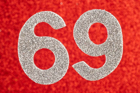 Number sixty-eight silver color over a red background. Anniversary. Horizontal Stock Photo
