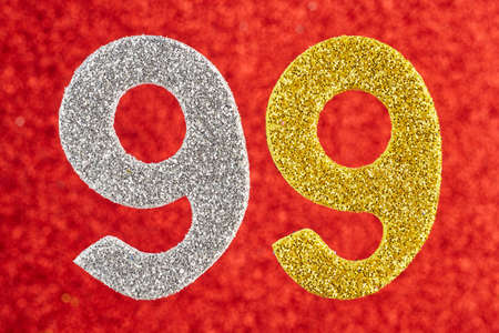 Number ninety-nine silver yellow color over a red background. Horizontal