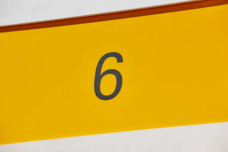 suite: Hotel room number in yellow background. Tourist apartment. Vacation