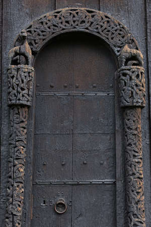 Lom medieval stave church door detail. Viking symbol. Norway tourism Imagens