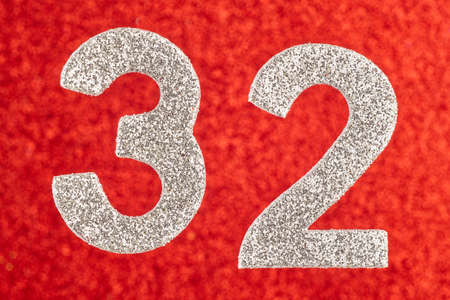 Number thirty-two silver color over a red background. Anniversary. Horizontal