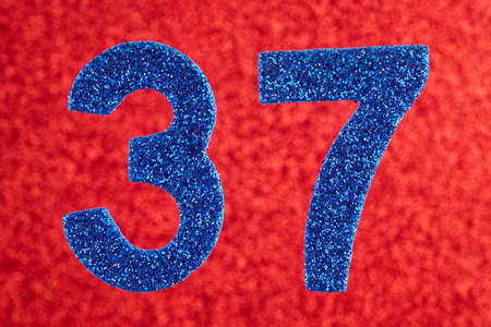 Number thirty-seven blue color over a red background. Anniversary. Horizontal Stok Fotoğraf