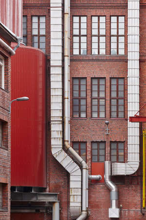 industrialised: Antique red brick factory building facade in Tampere. Finland. Vertical