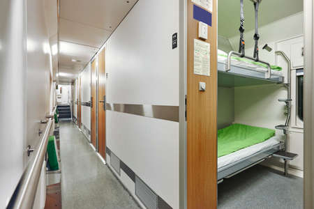Train berth corridor indoor with two beds. Travel background. Horizontal