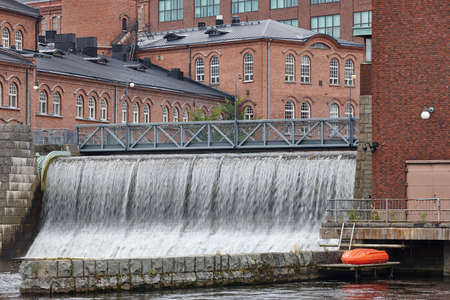 industrialised: Traditional industrial buildings and dam in Tampere city center. Finland