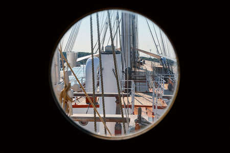 Sailing boat view from captain cabin door window. Copy space
