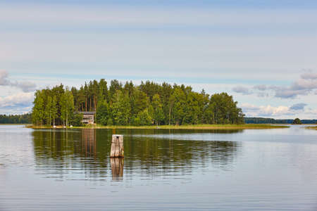 Finland landscape with lake forest island and lake. Finnish summer