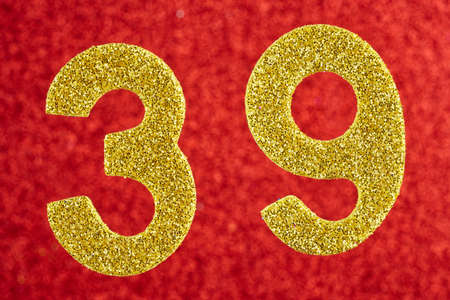Number thirty-nine gold color over a red background. Anniversary. Horizontal
