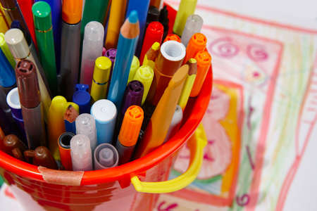 Colorful markers with color pencils and drawings. School material. Horizontal Stock Photo