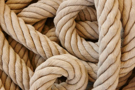 Thick rope with loops. Marine background. Horizontal