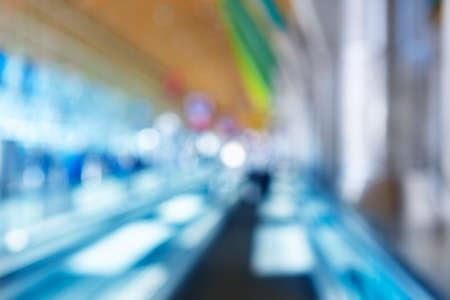 Airport terminal corridor indoor out of focus. Horizontal background