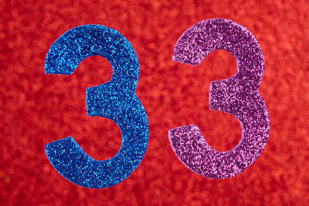 Number thirty-three blue purple color over a red background. Anniversary