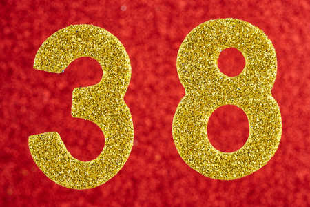 Number thirty-eight gold color over a red background.